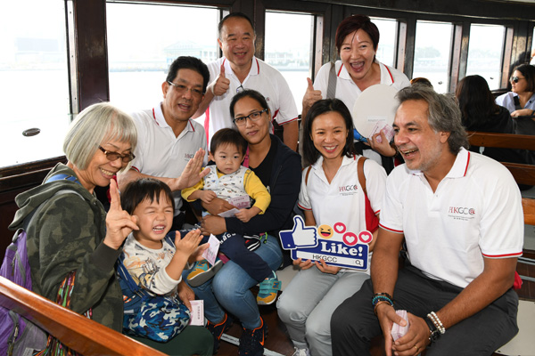 Chamber leaders greet passengers and hand out HKGCC souvenirs on board the Star Ferry.